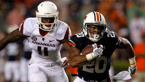 Auburn running back Corey Grant  (20) breaks free from Arkansas linebacker Randy Ramsey (11) and runs for a first down during the second half of an NCAA college football game on Saturday, Aug. 30, 2014, in Auburn, Ala. Auburn defeated Arkansas 45-21. (AP Photo/Butch Dill)