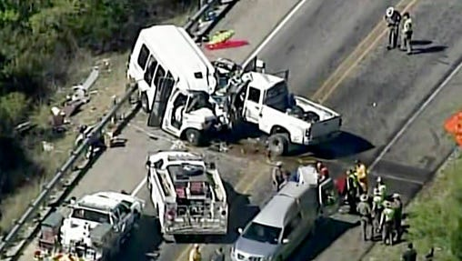 In this aerial image made from a video provided by KABB/WOAI authorities respond to a deadly crash involving a van carrying church members and a pickup truck on U.S. 83 outside Garner State Park in northern Uvalde County, Texas, Wednesday, March 29, 2017. The group of senior adults from First Baptist Church of New Braunfels, Texas, was returning from a retreat when the crash occurred, a church statement said.