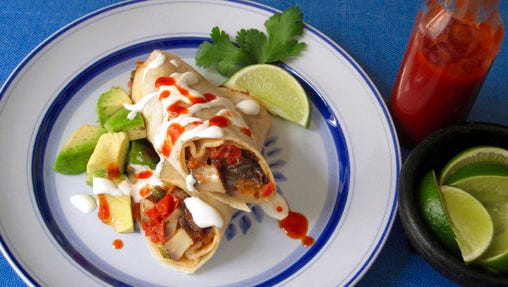 This April 2017 photo shows portobello, chile and cheese burritos in New York. This dish is from a recipe by Sara Moulton.