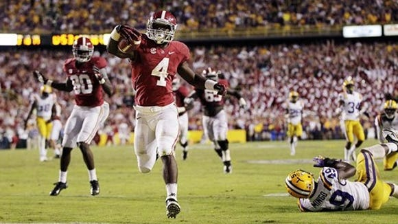 Alabama running back T.J. Yeldon scores the winning touchdown past LSU defensive end Barkevious Mingo on Saturday. GERALD HERBERT/AP Alabama running back T.J. Yeldon (4) scores the winning touchdown past LSU defensive end Barkevious Mingo (49) in the second half of their NCAA college football game in Baton Rouge, La., Saturday, Nov. 3, 2012. Alabama won 21-17. (AP Photo/Gerald Herbert)