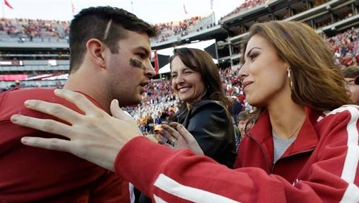 Alabama quarterback AJ McCarron, left, and Katherine Webb, are scheduled to get married July 11. Will it make reality TV.