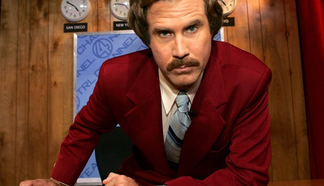 """Actor Will Ferrell as """"Ron Burgundy"""" from his new film """"Anchorman"""" appears on stage during MTV TRL Times Square Film Festival Week at the MTV Times Square Studios June 30, 2004 in New York City."""