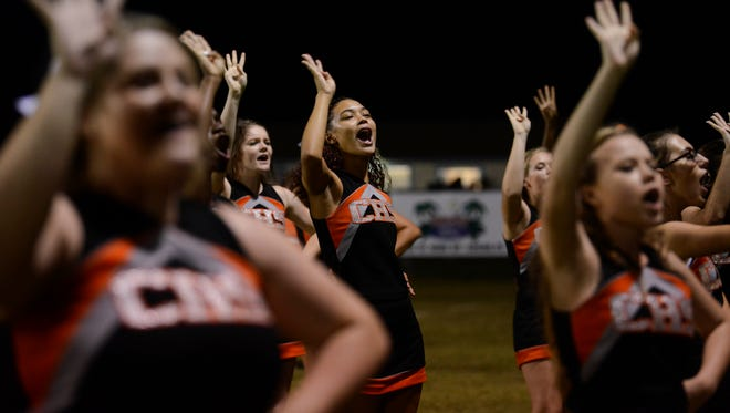 Cocoa cheerleaders welcome the 4th quarter during Friday's game at McLarty Stadium