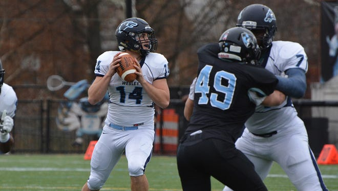 Wesley's Joe Callahan threw for 469 yards as the Wolverines defeated Johns Hopkins 42-37 in the NCAA Division III playoffs on Saturday.