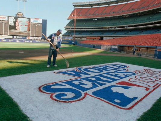 FILE - In this Oct. 24, 1986, file photo, Pete Flynn, New York Mets groundskeeper, puts the final touches on the World Series logo on the Shea Stadium field in New York, the day before Game 6 of the series. Flynn, a popular groundskeeper for the who spent five decades manicuring baseball diamonds from the Polo Grounds to Citi Field, died on Wednesday, June 21, 2017. He was 79. The team said Flynn died after a long illness. No other details were provided. (AP Photo/Susan Ragan, File)