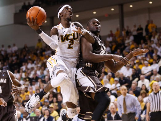 Virginia Commonwealth guard Briante Weber shoots the ball around St. Bonaventure center Youssou Ndoye in the second half at Stuart C. Siegel Center.