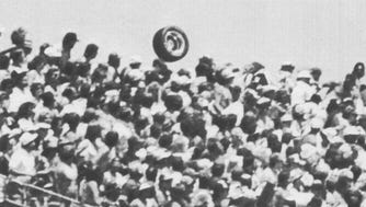 The tire that came off Tony Bettenhausen's car during the 1987 Indianapolis 500 first hit Roberto Guerrero's car, then flew into the stands at the Indianapolis Motor Speedway, killing Lyle Kurtenbach of Rothschild, Wisc.  A wheel from Tony Bettenhausen's car bounces over fans in the stands near the start of turn four at the Indianapolis Motor Speedway, May 25, 1987. Lyle Kurtenbach was kiled when the tire struck him.