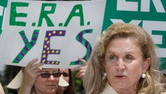 Rep. Carolyn Maloney, D-N.Y., right, speaks on Capitol