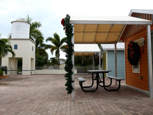 The Riverside Park Water Tower stands next to the cottages at Liles Hotel. Both are Bonita Springs' Designated Historic Properties.