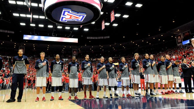 The Arizona Wildcats line up during the national anthem before facing the Stanford Cardinal before the first half March 2, 2014, at McKale Center.