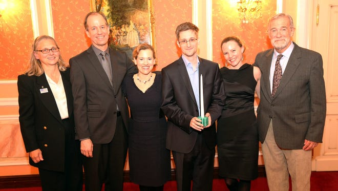 Edward Snowden (3rd R) receives the Sam Adams Associates for Integrity in Intelligence Award (SAAII) alongside UK WikiLeaks journalist Sarah Harrison (2nd R) who took Snowden from Hong Kong to Moscow and obtained his asylum and the United States government whistleblowers who presented the award (L-R) Coleen Rowley (FBI), Thomas Drake (NSA), Jesselyn Raddack (DoJ) and Ray McGovern (CIA) on October 9, 2013 in Moscow, Russia.