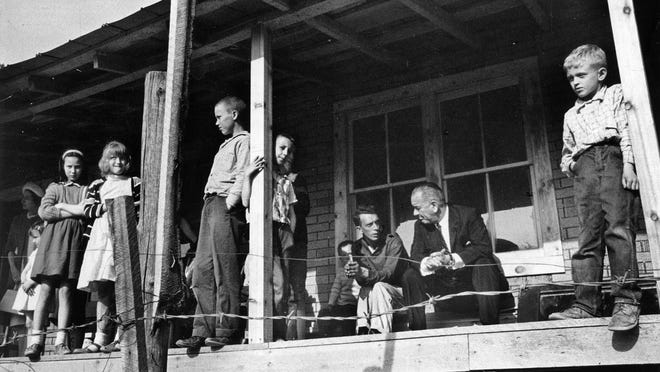 President Lyndon B. Johnson, who declared war on poverty, in 1964 visited Tom Fletcher on the front porch of his home at Inez in Eastern Kentucky.