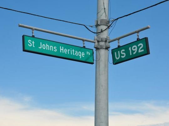 """The opening of the St. Johns Heritage Parkway has been delayed for months due to problems with the storm water system. """"Road closed"""" signs and orange barrels block off the intersection on 192 west of I-95."""