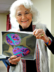 Dint Sweitzer shows a photograph she used to plan the team's egg colors.