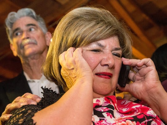 Mary Rose Wilcox talks on the phone as her husband consoles her. She was defeated in the Democratic primary for Congressional District 7 by Ruben Gallego.