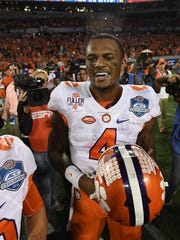 Clemson quarterback Deshaun Watson (4) celebrates the Tigers 42-35 win over Virginia Tech in the ACC Championship at Camping World Stadium in Orlando on Saturday, December 3, 2016.