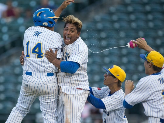 Moody celebrates around Dominik Lopez after defeating King in the Class 5A regional quarterfinal baseball series at Whataburger Field on Friday, May 19, 2017.