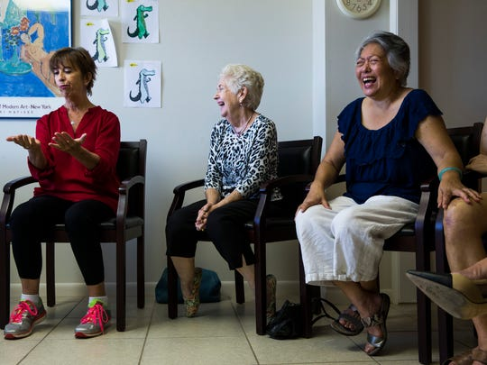 Julie Wang, from right, and Claire McKinney laugh as Margot Escott, a licensed therapist, performs a skit during an improvisational theater games class for people with ParkinsonÕs and caregivers in Naples on Tuesday, Nov. 7, 2017.