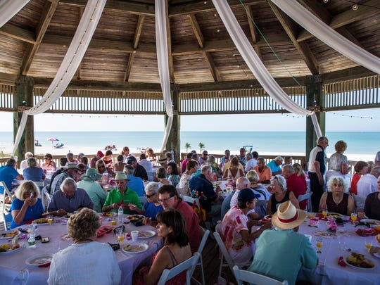 Couples enjoy a celebratory brunch together after renewing their vows during the 9th Annual Vow Renewal Ceremony at Lovers Key State Park on Wednesday, Feb. 14, 2018.