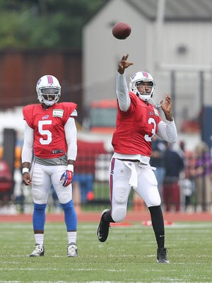 Bills QB EJ Manuel (3) throws downfield with Tyrod Taylor waiting his turn at training camp at St. John Fisher College.