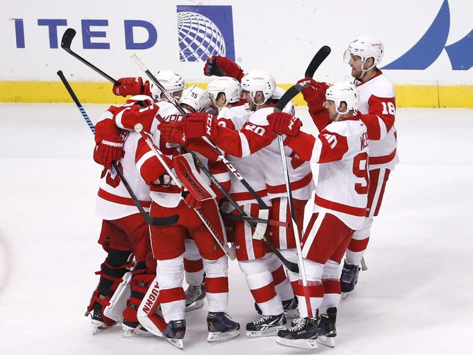 The Detroit Red Wings celebrate their 3-2 win over