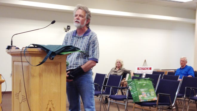 Terry Timme of the town's Office of Sustainability talks about the success of the ordinance banning single-use plastic bags in Silver City on Tuesday at the town council meeting.