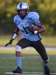 Lansing Catholic's Matthew Abdullah runs 17 yards on