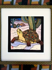 A wood block print by Nancy Frost Begin, the featured