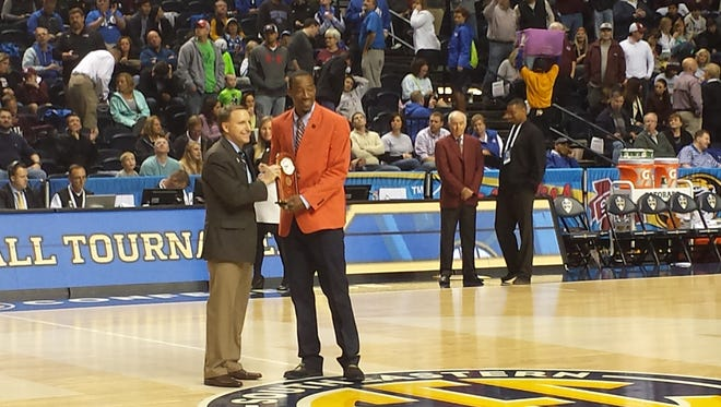 Former Auburn star Chris Porter was recognized Wednesday as an SEC Legend at halftime of Auburn-Mississippi State game.