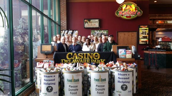 Delaware Park employees with the food they collected.