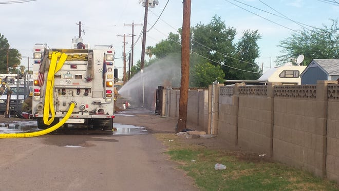 Fire crews control a fire being fed by a natural gas leak.