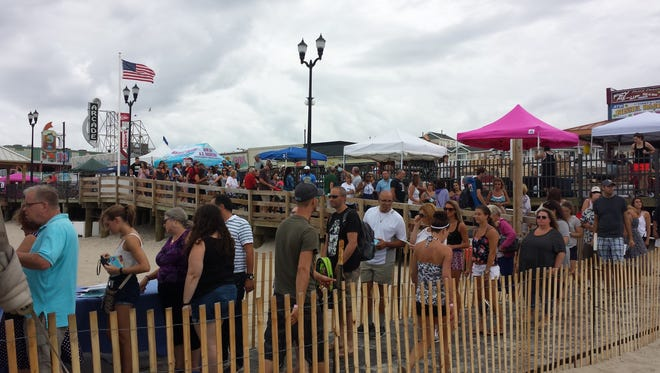Wine lovers line up on the Seaside Heights boardwalk on Saturday for the Jersey Shore's first ever beach wine festival.