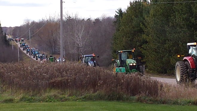A parade of 18 tractors welcomed Dillon Breyer home after he spent a month in the hospital. His hand was critically injured in a farm accident.