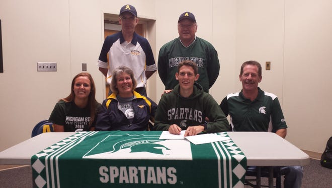 Morgan Beadlescomb (second from right) signs to Michigan State surrounded by his family and Algonac coaches.