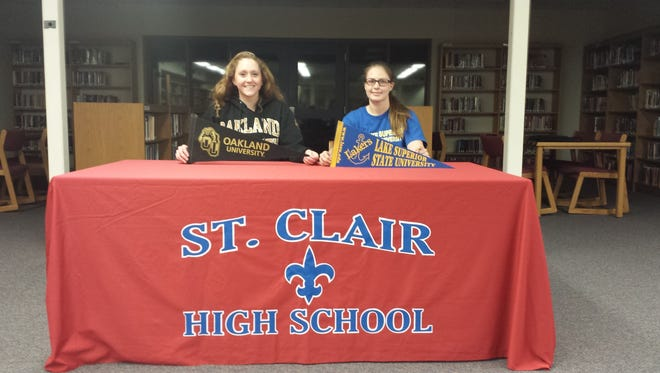 Grace Shinske (left) and Maddy Gapshes (right) announce their schools of choice