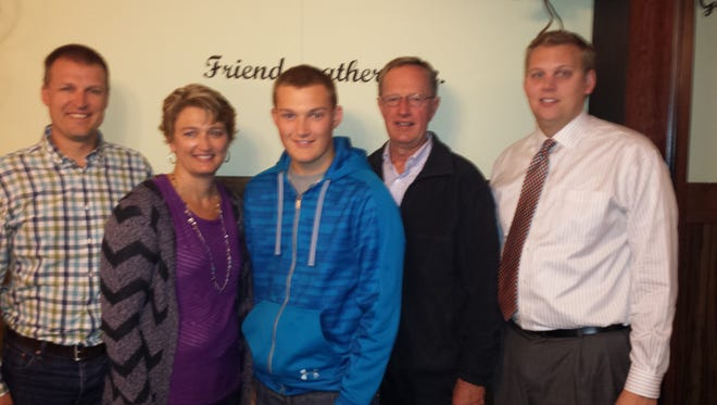 Posing with Dylan Vander Berg (center), during his last Kiwanis meeting are, from left: Mike Vander Berg, Bonnie Vander Berg, Kiwanian Cal VandeZande, Kiwanis President and Youth Leader Jon VenHuizen.