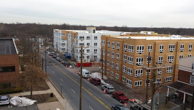 Construction  has been continuing throughout the winter on the Cobalt Apartments in Somerville.