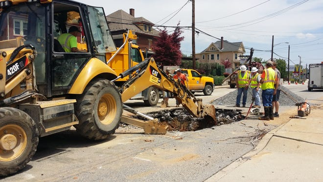 Crews work to repair a water main break on Sunday afternoon on Lincoln Way East in Chambersburg.