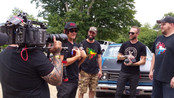 Norman Reedus films in Asheville with the men behind Howling Moon moonshine distillery.