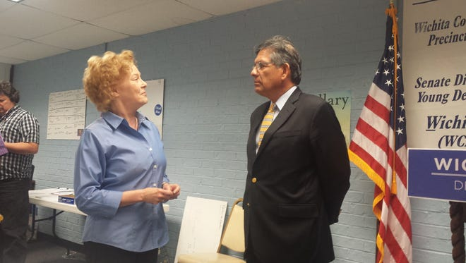 State Rep. Roberto Alonzo (D-Dallas) speaks with a Wichita County democrat in Wichita Falls on Wednesday.