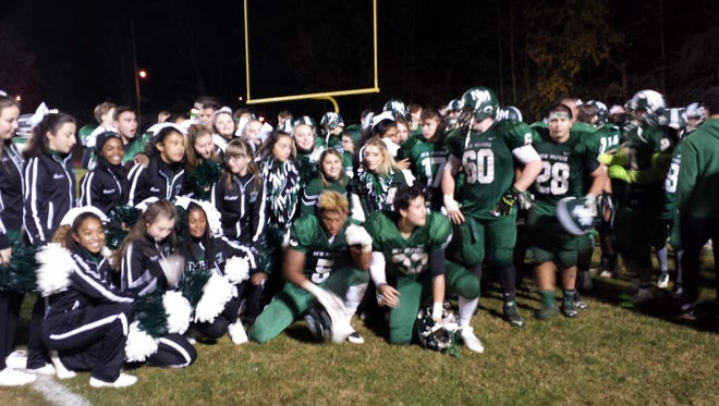 The New Milford football team celebrates after beating Becton on Friday.