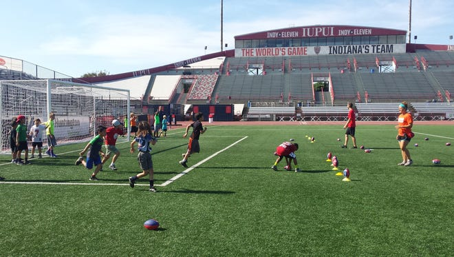Campers at IUPUI spring break camp enjoy a game of soccer.