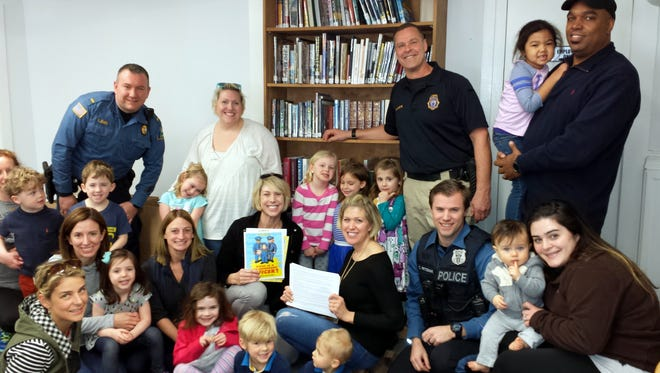 "Boonton police officers teach Pre-K kids about ""stranger-danger"" at the Holmes Library in Boonton. Saturday, April 8, 2017"