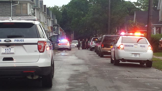 Rochester police officers at the scene of Sunday's stabbing on Weaver Street.