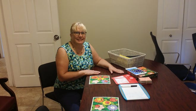 Mary Garner, one of the volunteers, is pictured getting ready to tutor a child at the shelter.