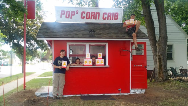 The Ruffi sons smile from Pop's Corn Crib.