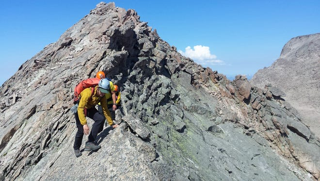 Members of the search team for 38-year-old Brian Perri of Fort Collins scale the ridge line near Mount Meeker in Rocky Mountain National Park July 7.