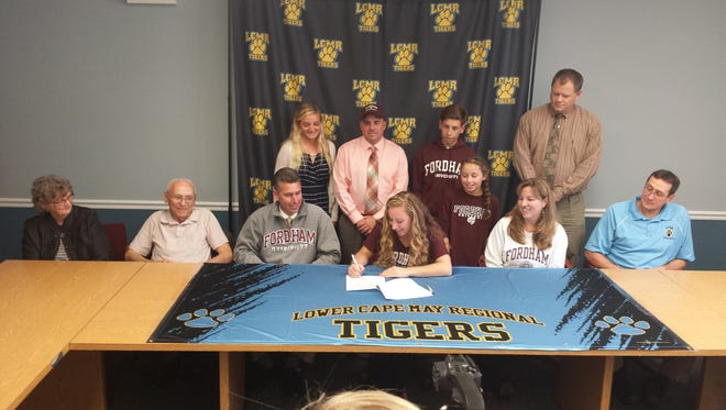 Lower Cape May's Lauren Holden (center) signs with Fordham University.
