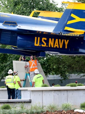 A Blue Angel F/A-18C Hornet was bolted to a pedestal as it was installed at the memorial for Blue Angels pilot Capt. Jeff Kuss in Lee Victory Recreation Park, on Friday, June 1, 2018.