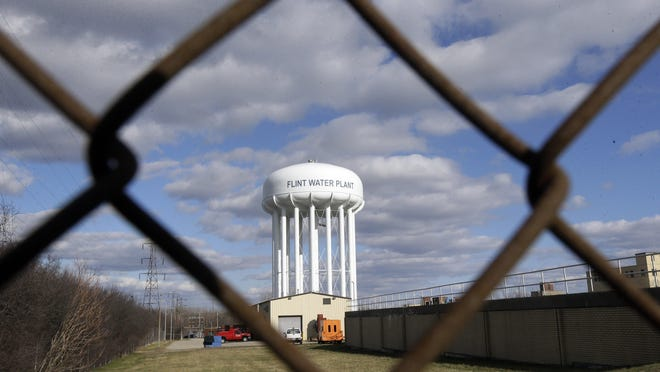 In this March 21, 2016, file photo, the Flint Water Plant water tower is seen in Flint.
